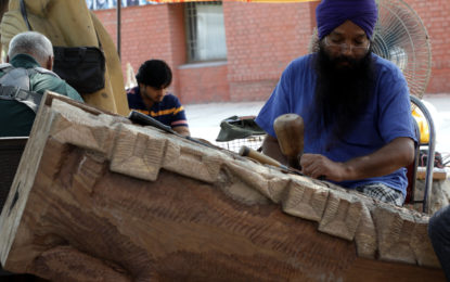 Sculptors creating Sculptures during Sculpture Camp (Wood) organising by NZCC at Kalagram, Manimajra, Chandigarh from June 20 to July 4, 2017